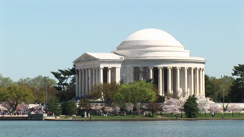 Tourists walk around the Jefferson Memorial in Washington, DC Live Action