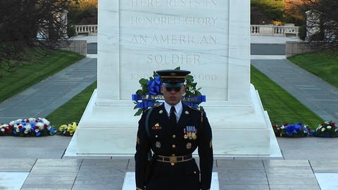 A decorated soldier stands in front of a monument and... Stock Video Footage
