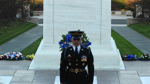 A decorated soldier stands in front of a monument and gives a speech Footage