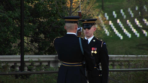 A soldier stands at attention in full uniform as another... Stock Video Footage