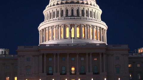 The camera slowly pans up the Capitol Building to the beautiful Capitol Dome with the eagle statue o Footage