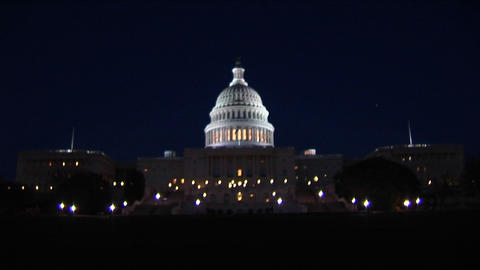 A long shot of the Capitol Building illuminated at night Footage