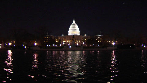 The Capitol Dome is illuminated as a reflecting pool shimmers below Footage
