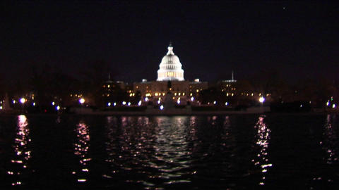 The Capitol Dome is illuminated as a reflecting pool... Stock Video Footage