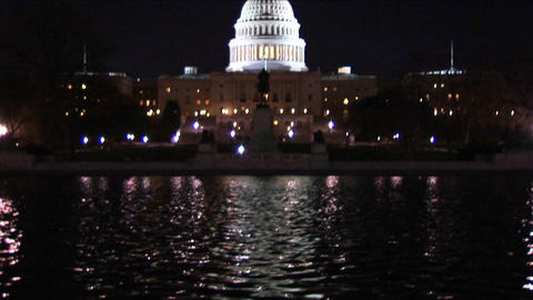 Lights from the U.S. Capitol Building are reflected in a fountain Footage