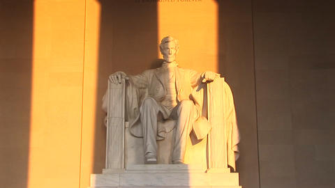 Golden light spills over a statue of President Lincoln Stock Video Footage