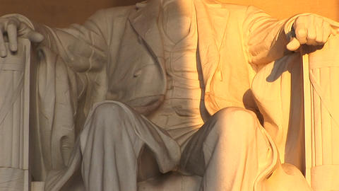 Close up of a statue of President Lincoln bathed in golden light Footage