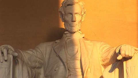 Close up of a statue of President Lincoln bathed in... Stock Video Footage