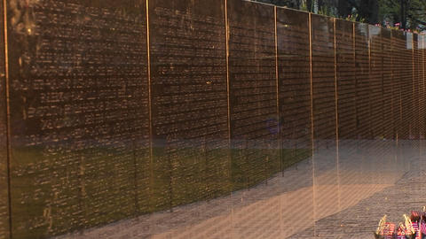Close up of the Vietnam Veterans Memorial Wall with tributes and mementos in front Footage