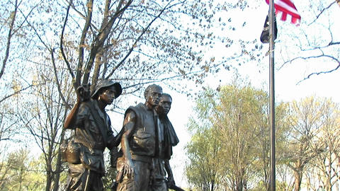 A pan-up to a United States flag from the Three Soldiers sculpture in Washington, DC Footage