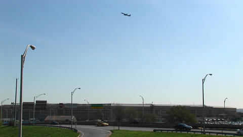 An airplane is seen flying above the Pentagon Freeway Footage