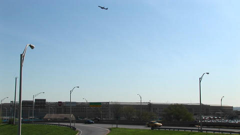 An airplane is seen flying above the Pentagon Freeway Stock Video Footage