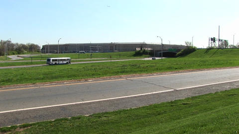A tour bus travels down the freeway towards the Pentagon... Stock Video Footage