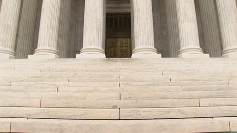 An upward pan of the front of the Supreme Court Stock Video Footage