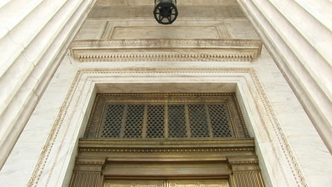 View of columns and lamp above bronze doors at the west... Stock Video Footage