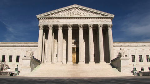 View of the columns and steps at the front entrance to the U.S. Supreme Court building in Washington Footage