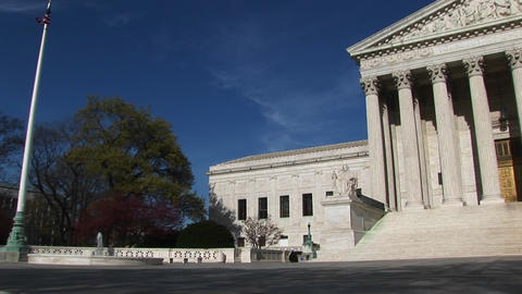 A pan-right along the U.S. Supreme Court Building and... Stock Video Footage