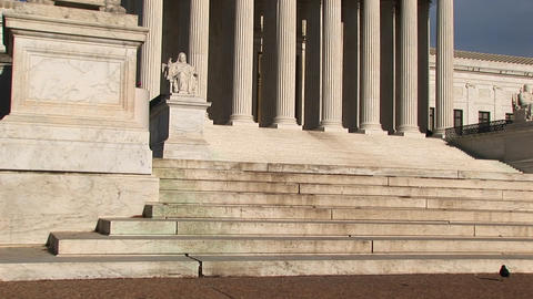Warm sunlight shines on the white stone steps and bright... Stock Video Footage