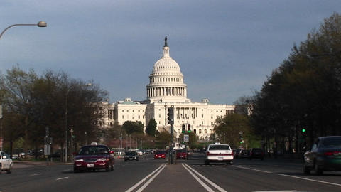Camera zooms to a medium shot of the U.S. Capitol... Stock Video Footage