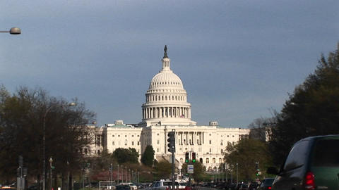 Camera zooms to a medium shot of the U.S. Capitol building's wedding-cake dome topped by the massive Footage