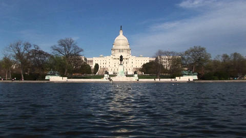 Zooming across the Reflecting Pool in Washington, DC and ending on the U.S. Capitol building Footage