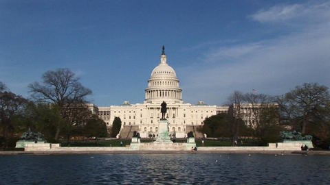 The camera zooms in across the U.S. Capitol Reflecting... Stock Video Footage