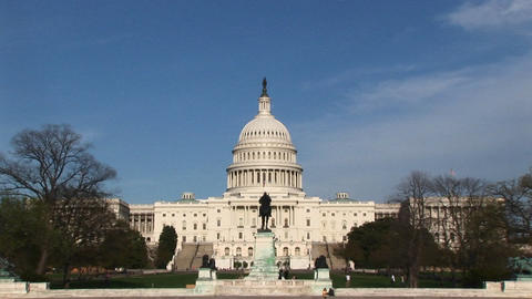 The camera zooms in across the U.S. Capitol Reflecting Pool to the west-facing side of the Capitol's Footage
