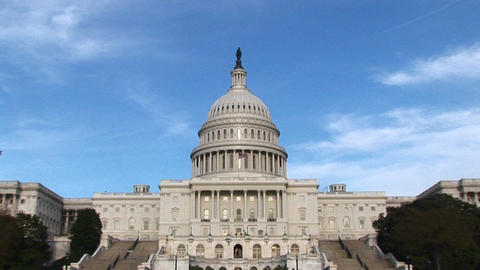 From a long-shot of the eastern facade of the U.S. Capitol building in Washington, DC, the camera zo Footage