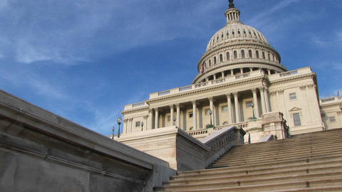 Looking up the steps of U.S. Capitol building for a view of the portico and dome Footage