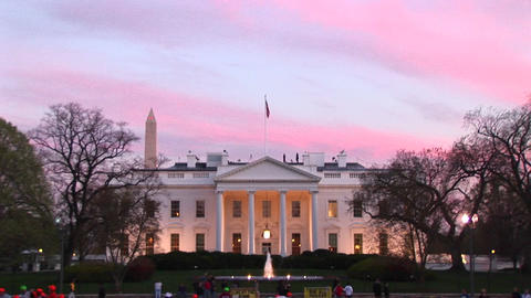 Looking at the well-lit White House on a late wintry afternoon with the American flag and Washington Footage