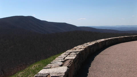 Long-shot of a low stone wall along a road in the Blue Ridge Mountains of Virginia Footage