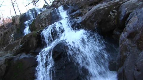 A mountain stream cascading over rocks on its way downstream Stock Video Footage
