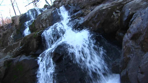 A mountain stream cascading over rocks on its way downstream Footage