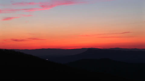 A slow pan across a deepening sunset Stock Video Footage