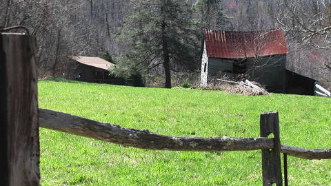Camera peers over split rail fence that frames abandoned... Stock Video Footage