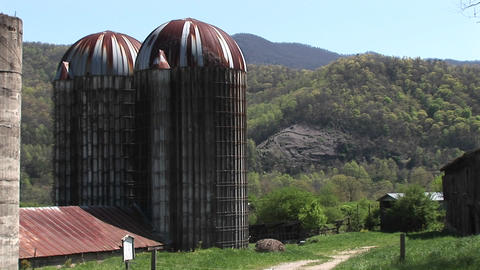 large grain silos and the surrounding mountains dominate... Stock Video Footage