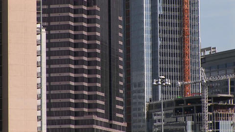 Pan-up of three tall buildings in the city of Atlanta and... Stock Video Footage