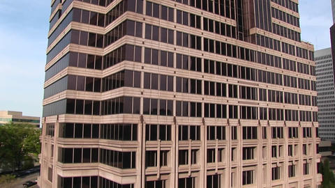 The camera pans-up from the grounds to a tall skyscraper... Stock Video Footage