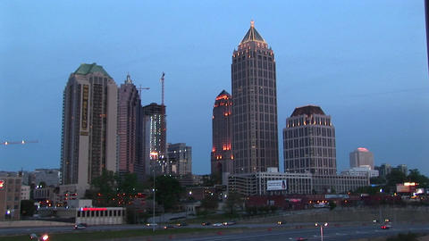 Skyscrapers make up the background for a golden-hour shot of traffic flowing along on an Atlanta fre Footage