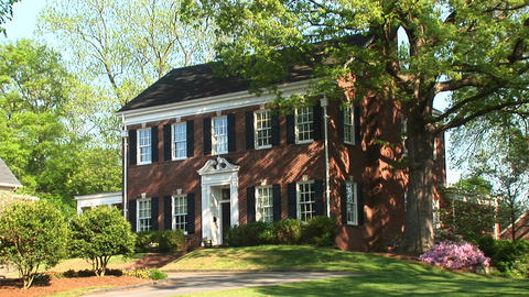 A beautiful, Georgian Colonial house surrounded by trees... Stock Video Footage