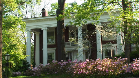 A medium-shot of an old, but well kept, country home... Stock Video Footage
