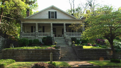 Beautiful landscaping and a large, welcoming porch... Stock Video Footage