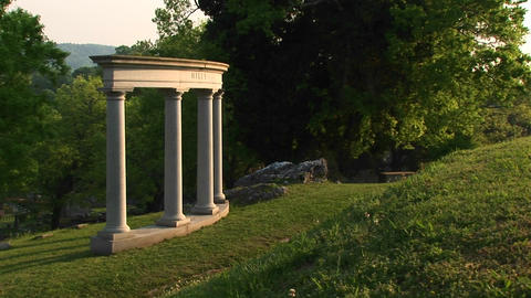Four stately architectural columns grace a manicured... Stock Video Footage