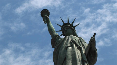 The camera pans-left across the Statue of Liberty Stock Video Footage