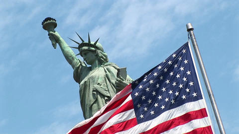 A tilted view of an American flag as it waves in front of... Stock Video Footage