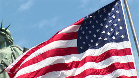 The camera pans-left across a rippling American flag,... Stock Video Footage