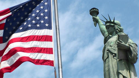 The camera pans-right across a rippling American flag,... Stock Video Footage