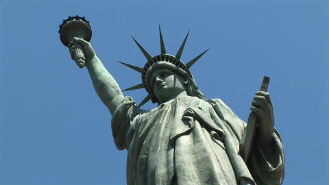 The camera looks up at a towering Statue of Liberty, set... Stock Video Footage