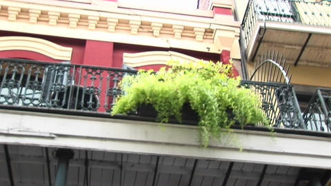 A worms-eye view of balconies on a brightly painted building Footage