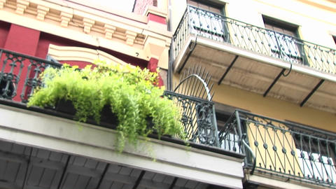 A worms-eye view of balconies on a brightly painted building Stock Video Footage